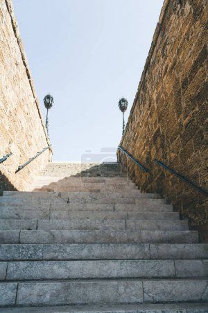 Photo for Bottom view of stairs with walls and railings - Royalty Free Image
