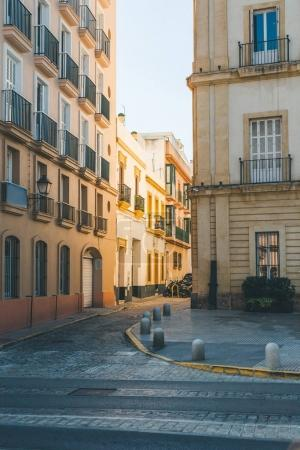Photo for View of spanish street with buildings under clear sky - Royalty Free Image