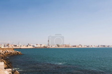 panoramic view of spanish city coastline under blue sky