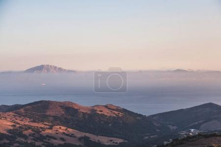 scenic view of beautiful mountains landscape with sea and fog, spain