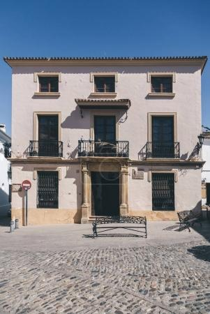 facade of small spanish building under blue sky