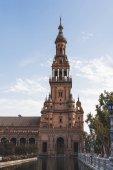 """Постер, картина, фотообои """"эклектичный башня под голубым небом, Севилья, Испания"""""""