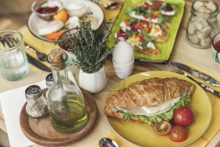 close-up view of tasty healthy breakfast with sandwich and boiled egg on table