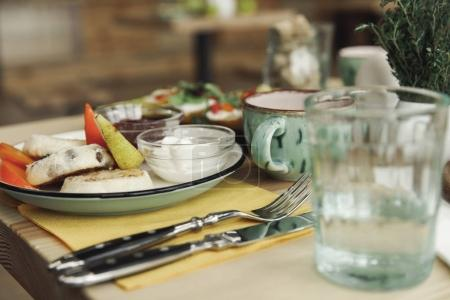 Photo for Close-up view of utensils, cutlery and healthy breakfast on table - Royalty Free Image