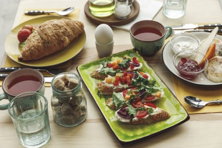 Photo for Close-up view of fresh tasty sandwiches and breakfast on table - Royalty Free Image