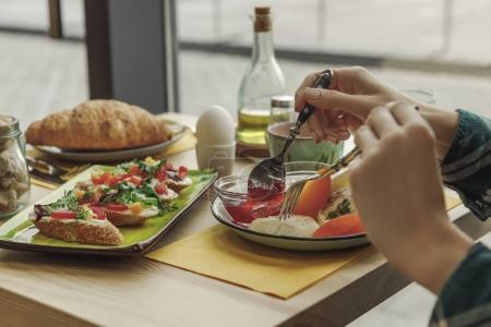 Photo for Cropped shot of person eating healthy tasty breakfast - Royalty Free Image