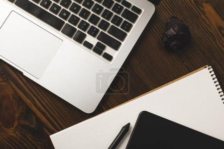 close-up view of graphics tablet, notebook, laptop and seashell on table