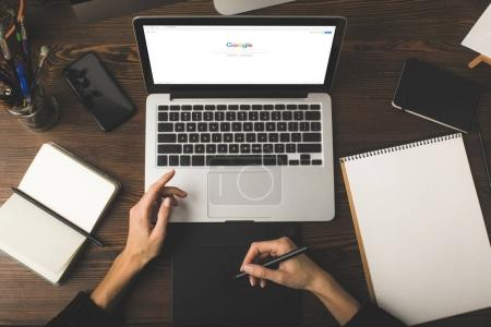 Photo for Cropped shot of designer using graphics tablet and laptop with google website on screen - Royalty Free Image