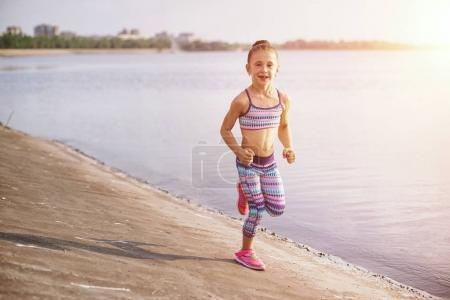 Photo for Healthy lifestyle - child girl running, jumping outdoor - Royalty Free Image