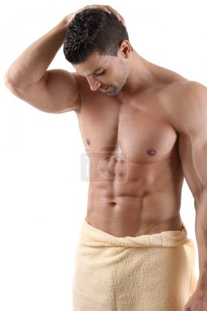 Handsome muscular male posing in front of white background