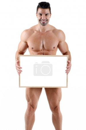 Handsome muscular male shows blank board in front of white background