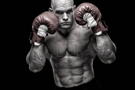 Powerful fighter in front of black background
