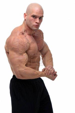 Bodybuilder posing, isolated on white background