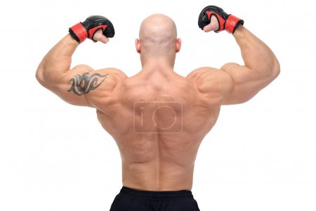 Powerful fighter posing in front of white background