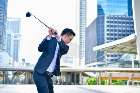 Concept Business people playing sports, Businessmen play golf to