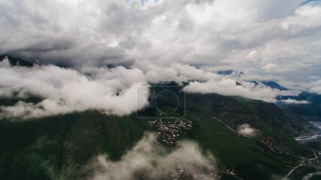 cloudy mountains with city