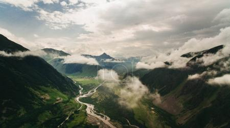 Photo for Aerial view of river in green scenic mountains with clouds, Georgia - Royalty Free Image