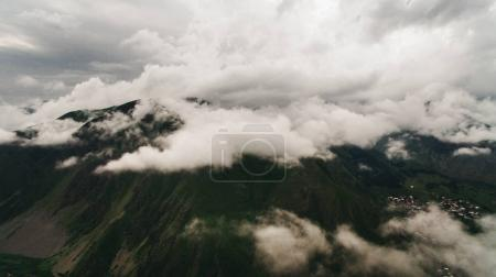 Photo for Aerial view of green scenic mountains with clouds, Georgia - Royalty Free Image