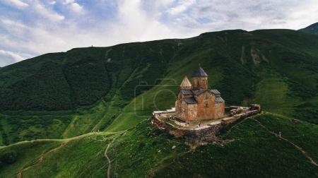 Photo for Aerial view of old castle in green cloudy mountains, Georgia - Royalty Free Image