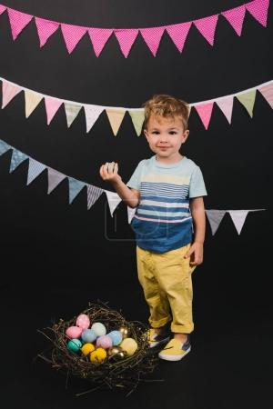 kid and easter eggs