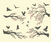Flock of flying birds on tree branches