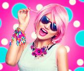 Teenage model girl with pink hair