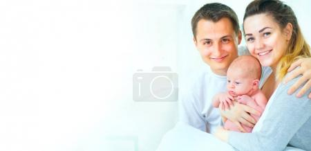 Happy young family with newborn baby on white background