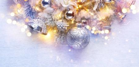 Silver Christmas decoration balls over white wooden background