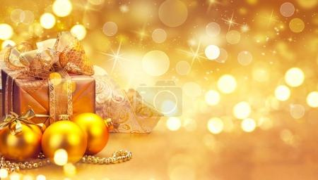 Christmas golden baubles and decorations on blurred background