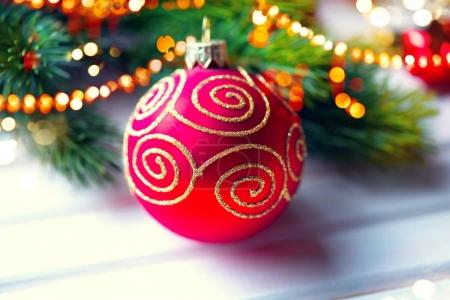 Close view of christmas decoration ball over white wooden background