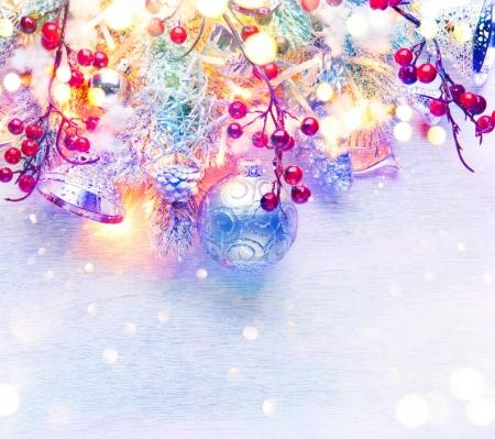 Silver Christmas decoration with lights on snowy background