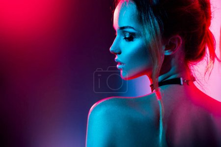 woman with trendy make-up in colorful bright lights