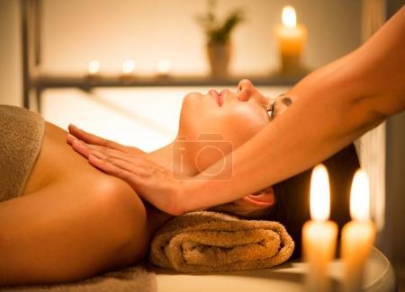 woman enjoying relaxing spa facial massage
