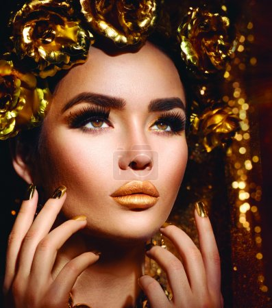 Woman with fashion golden makeup and accessories