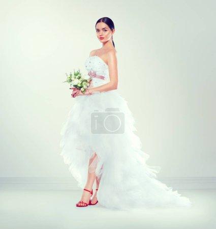 model bride in wedding dress with long train