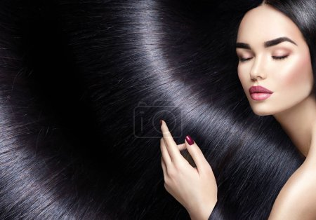 woman profile with long straight black hair as background