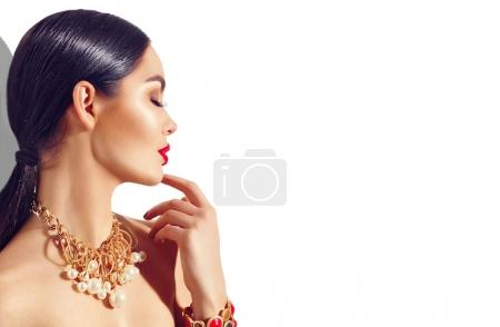 fashion model with red lips and trendy golden accessories