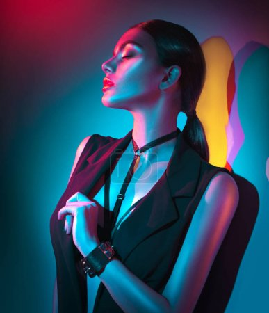 young woman with red lips in black clothes on colorful background