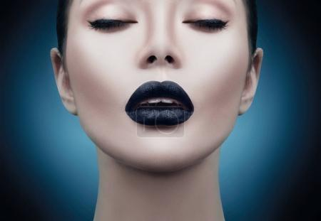 model girl portrait with trendy gothic black makeup