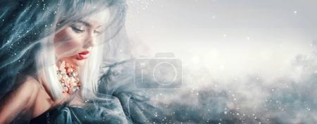 Fashionable woman with makeup and accessories on smoky background