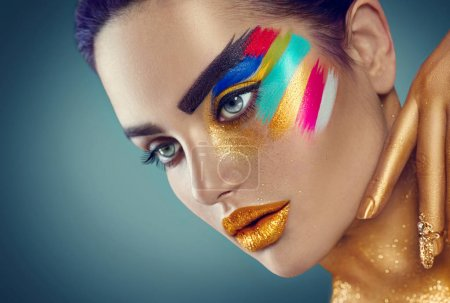 Beauty fashion art portrait of beautiful woman with colorful abstract makeup