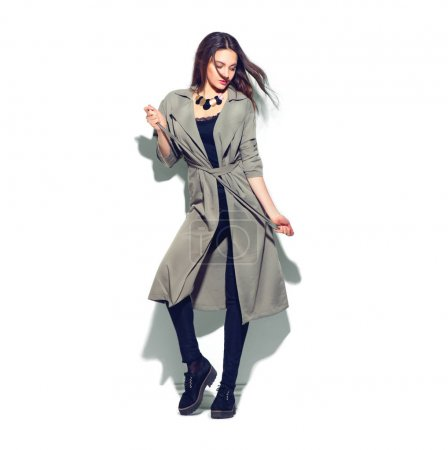 Fashionable woman in grey coat and trendy accessories