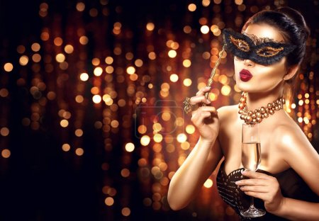 woman with glass of champagne and lace masquerade mask on face