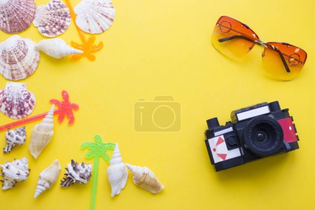 Yellow background with travelling items