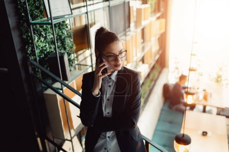 Businesswoman talking on mobile.