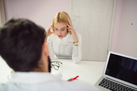 Beautiful young blonde woman at doctor's office.