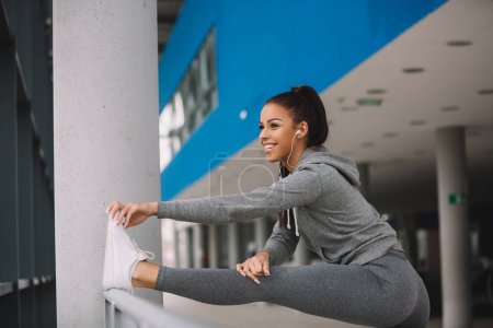 Fit woman stretching after workout.