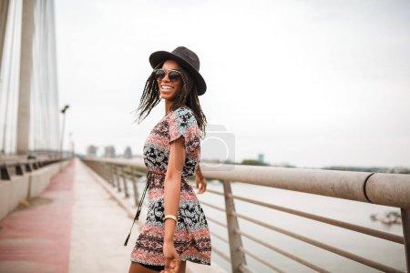 Beautiful african american girl walking on a bridge