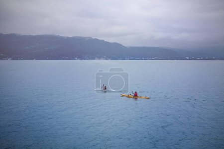Two kayaks on lake, cloudy weather