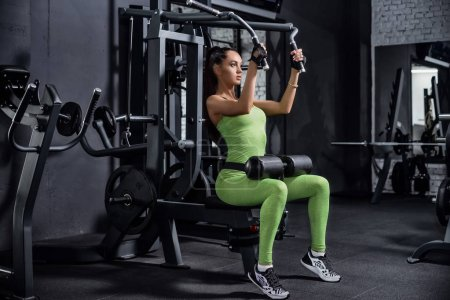 Photo for Training in the gym. Fitness girl to lift weights. Fitness trainer to warm up. Workout on the tone muscles - Royalty Free Image